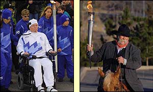 Torchbearer Christopher Reeves carries the Olympic Flame during the 2002 Salt Lake Olympic Torch Relay in Brooklyn, New York