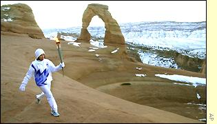 Stephanie Spann passes Delicate Arch in Arches National Park, Utah