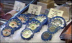 Various types of caviar on ice in shop display