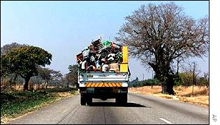 A truck carries black workers' possessions away after they have been evicted from a white-owned farm