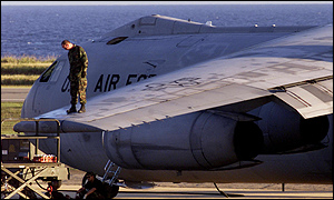 US Air Force personnel check over a C-141 transport plane at Guantanamo Bay, Cuba