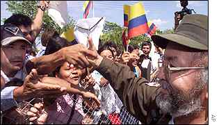 FARC commander Raul Reyes greets peace protesters in front of where talks were held in Los Pozos