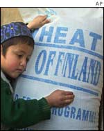 Afghan boy with Finnish food aid
