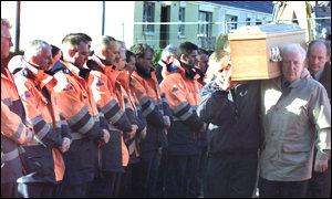 Postal workers, friends and family attended the funeral