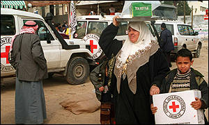 Woman and child receive emergency relief supplies in Rafah Gaza