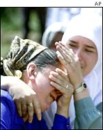 Bosnian Muslim women mourn their dead