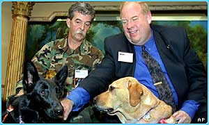 Roselle with owner Michael Hingson, right, and another guide dog, Tsunami, left