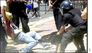 Riot police tackle a demonstrator in Argentina