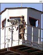 Cuban soldier on lookout in Guantanamo