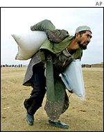 A man carrying a sack of grain