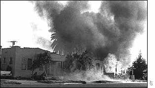 The remains of a burned out Los Angeles house where six SLA members died