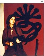 Heiress Patty Hearst in front of the SLA symbol