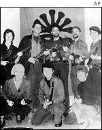 The Symbionese Liberation Army pose for a photo with their leader Cinque Mtume (centre, standing)