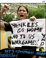Students shout slogans in front of the US embassy in Manila, 16 January 2002