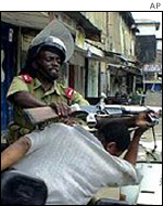 Police clash with CUF supporter, October 2000
