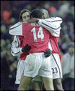 Arsenal's players celebrate Pires' goal