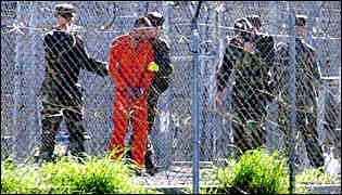 Escorted prisoner at Guantanamo Bay Cuba