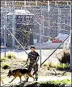 A guard checks the security at the camp at Guantanamo