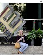 A woman waits for her husband outside the Enron headquarters