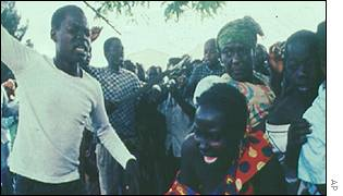 Refugee being beaten in refugee camp in Goma area in 1996