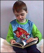 boy reading at home