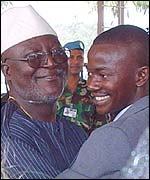 Sierra Leone Defence Minister Chief Hinga Norman, left, embraces interim Rebel Leader Issa Seesay