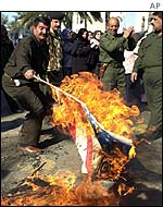 Iraqis burn a US flag on the anniversary of the Gulf War