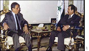 Amr Moussa, left, meets Saddam Hussein in Baghdad on Saturday