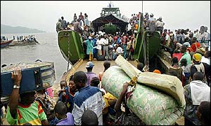 A boat packed with refugees prepares to return to Goma