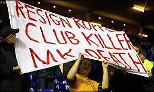 Wimbledon fans appeal against the move to Milton Keynes at a recent game against Birmingham
