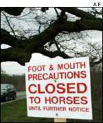 Sign warning horseriders off infected area,  AP