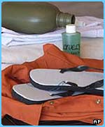 Prisoner's jumpsuit, sandals, flask and shampoo