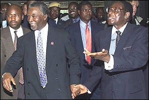 Presidents Thabo Mbeki and Robert Mugabe