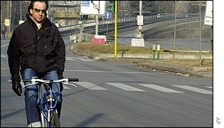 Car-free road with cyclist in Milan