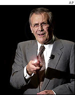 Donald Rumsfeld with laser pointer