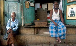 Two men sitting on veranda, Rangoon