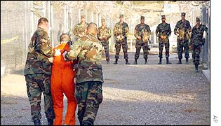 US soldiers escort a prisoner