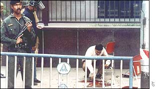 Policeman guards forensic investigation at American Center, Calcutta