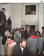 Crowds gather outside scene of Nablus shootings
