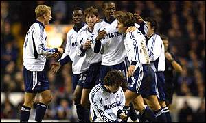 Tim Sherwood is congratulated by Spurs players