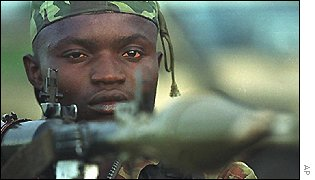Congolese rebel soldier armed with grenade launcher