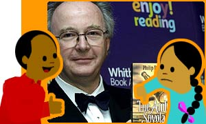 Philip Pullman proudly displaying The Amber Spyglass