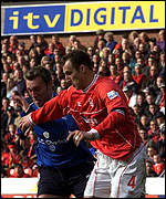 Nottingham Forest's captain Riccardo Scimeca (right) battles with Crewe's Dean Ashton 13 April 2002
