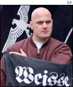 German skinhead next to neo-Nazi flag at demo in 1999