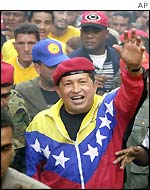 President Hugo Chavez surrounded by supporters in downtown Caracas
