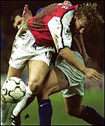 Arsenal's Ray Parlour battles for the ball