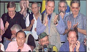 Low from left, Colombia�s peace commissioner, Camilo Gomez; FARC negotiator, Raul Reyes; and UN envoy, James LeMoyne with some of the diplomats who facilitated the talks
