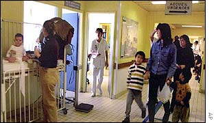 A French family waits for treatment in the emergency department