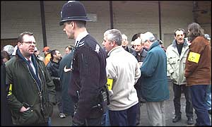 Police guard the picket line