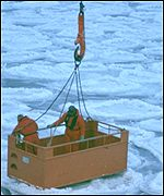 Researchers are lowered from an ice-breaking ship